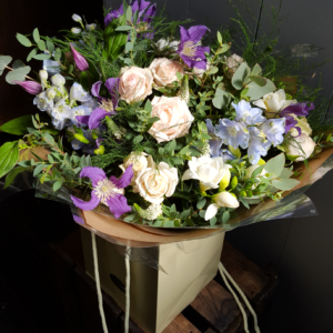 blue Delphiniums, Clematis and scented Freesias, Spray Rose, Veronica